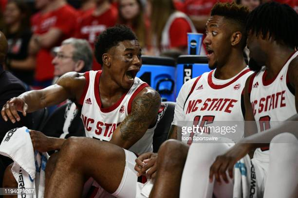 North Carolina State Wolfpack guard Markell Johnson reacts to a play on the court with teammates North Carolina State Wolfpack forward Manny Bates...