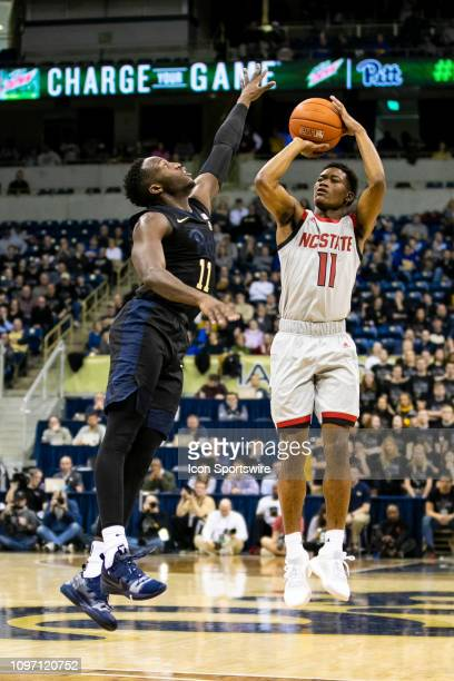 North Carolina State Wolfpack guard Markell Johnson shoots a jump shot during the college basketball game between the North Carolina State Wolfpack...