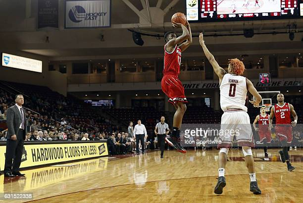 North Carolina State Wolfpack guard Markell Johnson shoots over Boston College guard Ky Bowman during an ACC match up between the Boston College...