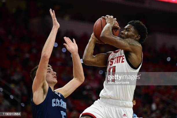 North Carolina State Wolfpack guard Markell Johnson shoots over Citadel Bulldogs guard Jerry Higgins III on a drive during the game between the NC...