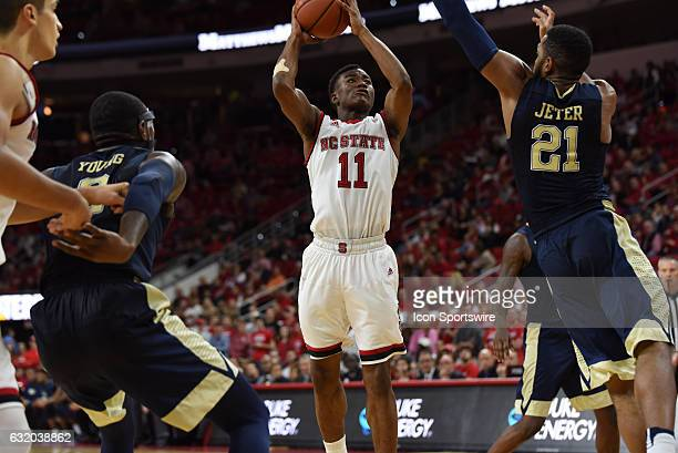 North Carolina State Wolfpack guard Markell Johnson shoots over Pittsburgh Panthers forward Sheldon Jeter during a game between the Pittsburgh...