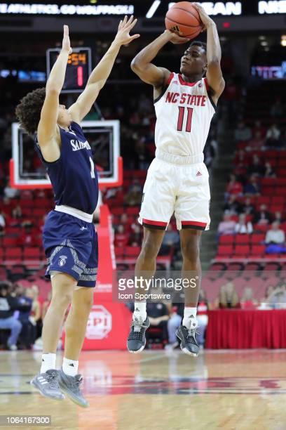 North Carolina State Wolfpack guard Markell Johnson shoots the ball while North Carolina State Wolfpack forward Sacha KilleyaJones attempts to block...