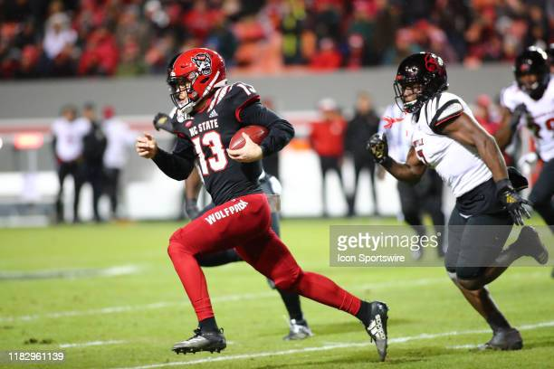 North Carolina State Wolfpack quarterback Devin Leary runs with the ball during the 1st half of the NC State Wolfpack game versus the Louisville...