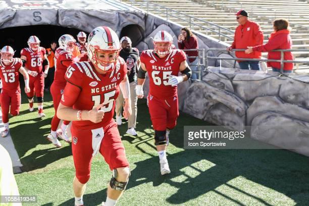 North Carolina State Wolfpack quarterback Ryan Finley and North Carolina State Wolfpack center Garrett Bradbury and team onto the field during...