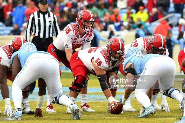 North Carolina State Wolfpack quarterback Ryan Finley prepares for the snap from center Garrett Bradbury during the college football game between the...