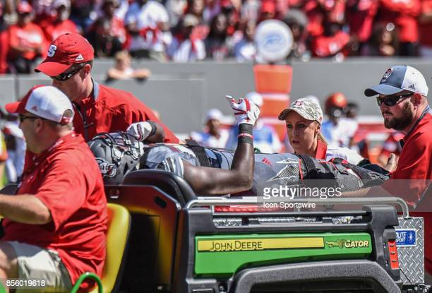 North Carolina State Wolfpack running back Dakwa Nichols holds a thumbsup while carted from the field after getting injured during the NCAA football...