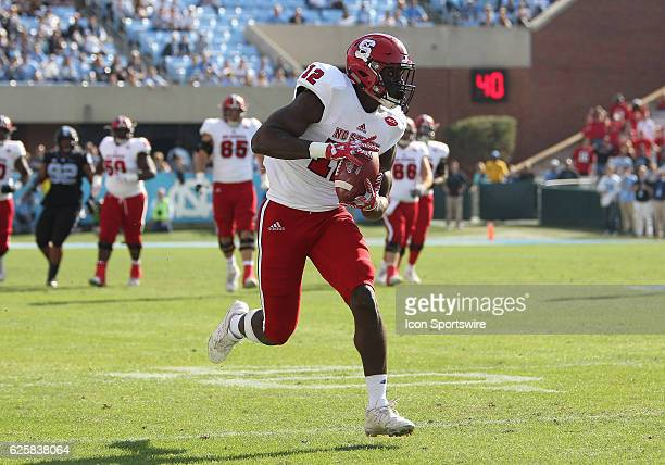 North Carolina State Wolfpack wide receiver Stephen Louis catches a pass for a touchdown during the NCAA football game between the North Carolina...