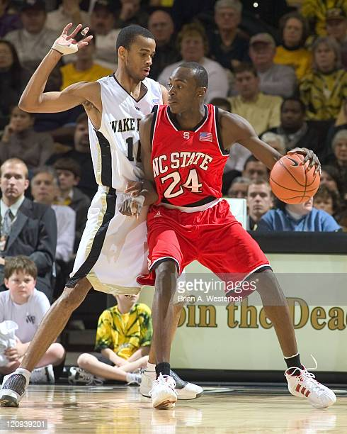 North Carolina State's Julius Hodge tries to back down Wake Forest's Jamal Levy during first half action at the LJVM Coliseum in Winston-Salem, NC,...
