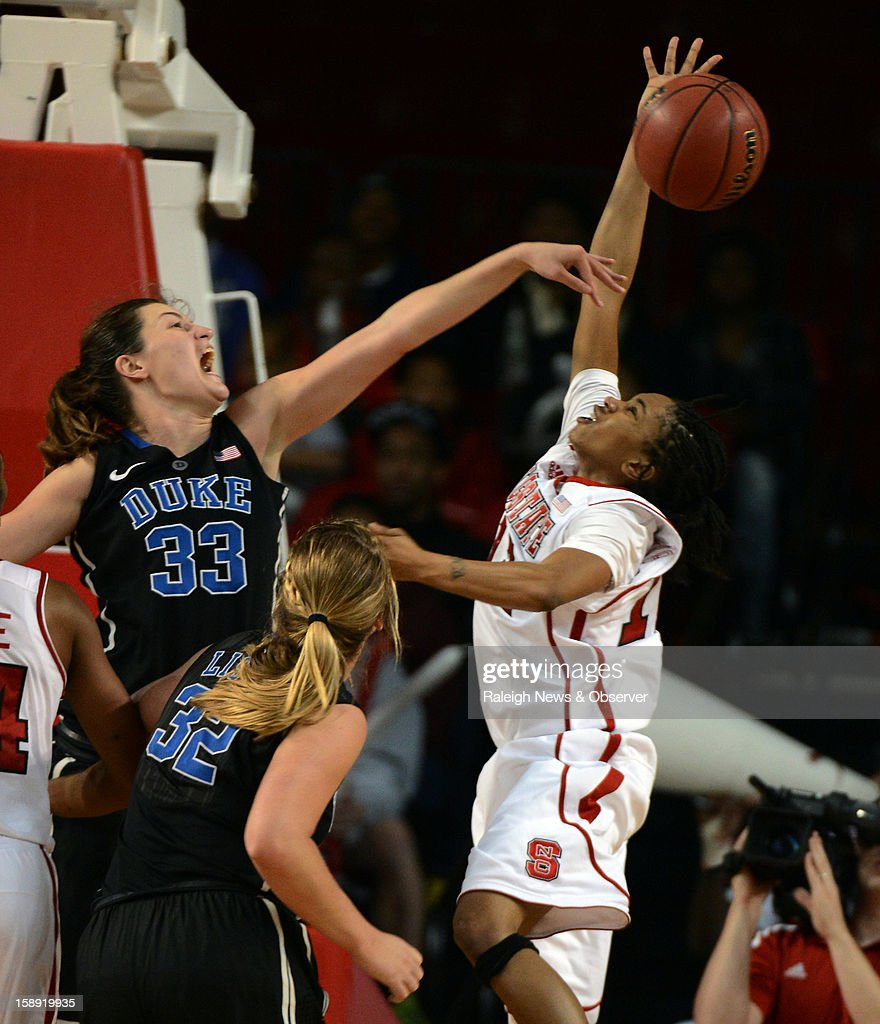North Carolina State's Krystal Barrett, right, has a shot rejected by Duke's Haley Peters (33) in the second half at Reynolds Coliseum in Raleigh, North Carolina, on Thursday, January 3, 2013. Duke won, 67-57.