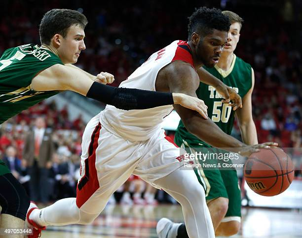 North Carolina State's Lennard Freeman pulls in a rebound as William Mary's Greg Malinowski trails during the first half at PNC Arena in Raleigh NC...