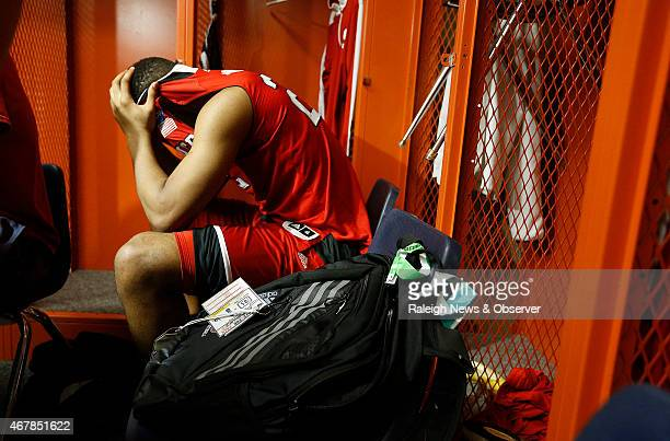 North Carolina State's Ralston Turner sits in the locker room after a 7565 loss against Louisville in an NCAA Tournament East Region Sweet 16 game at...