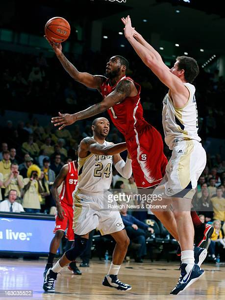 North Carolina State's Richard Howell shoots two past Georgia Tech's Kammeon Holsey left and Daniel Miller in the first half at McCamish Pavilion in...