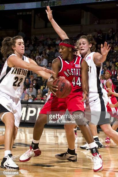 North Carolina State's Tiffany Stansbury is surrounded by Wake Forest's Christen Brown and Corinne Groves during second half action at the Joel...