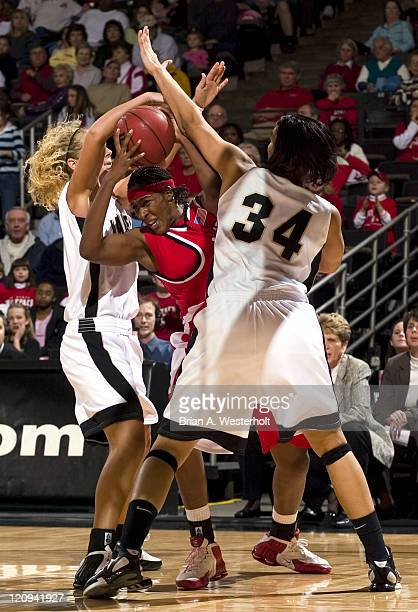 North Carolina State's Tiffany Stansbury is trapped by Wake Forest's Melissa Washington and Liz Strunk during second half action at the Joel Coliseum...