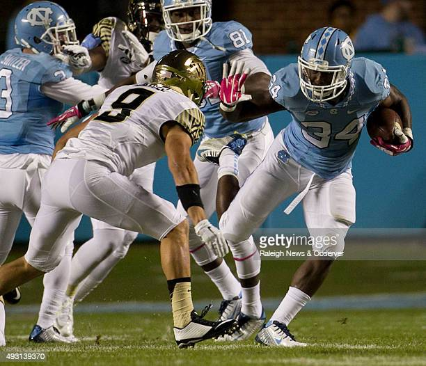 North Carolina tailback Elijah Hood looks for running room against Wake Forest's Zach Dancel in the first quarter on Saturday Oct 17 at Kenan Stadium...