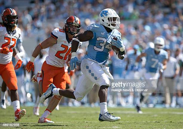 North Carolina tailback Elijah Hood races ahead of Illinois' Clayton Fejedelem and LaKeith Wall for a 28yard touchdown in the fourth quarter on...