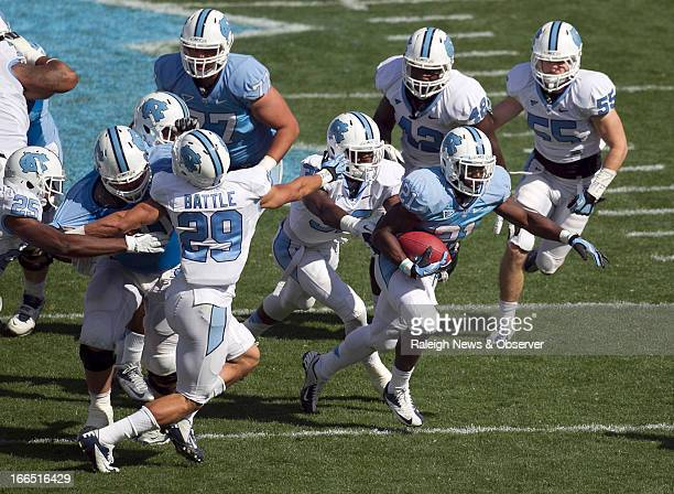 North Carolina tailback Romar Morris breaks through the White team defense for a long gain during the Tar Heels' Spring football game at Kenan...
