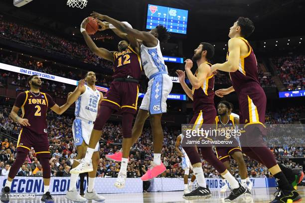 North Carolina Tar Heels and the Iona Gaels fight for a rebound in the first round of the 2019 NCAA Photos via Getty Images Men's Basketball...