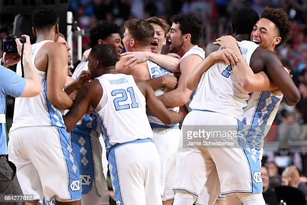 North Carolina Tar Heels basketball players celebrate after time expires during the 2017 NCAA Men's Final Four National Championship game against the...