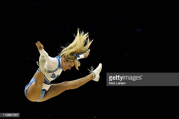 North Carolina Tar Heels cheerleader performs while playing the Kentucky Wildcats in the east regional final of the 2011 NCAA men's basketball...