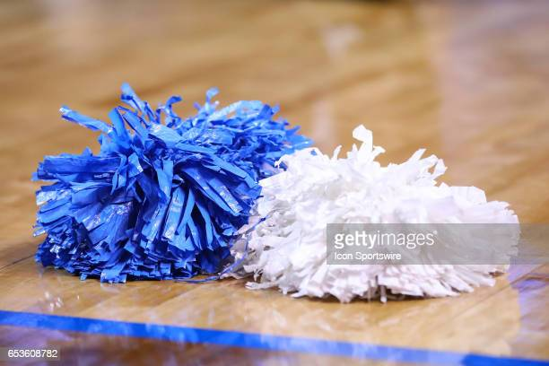 North Carolina Tar Heels cheerleaders pompoms on the court during the first half of the 2017 New York Life ACC Tournament third round game between...