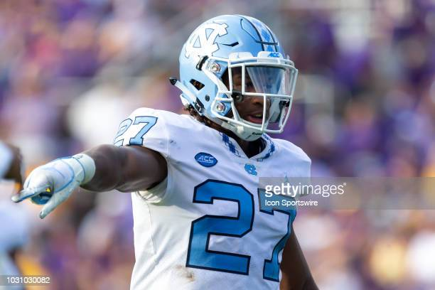 North Carolina Tar Heels defensive back Trey Morrison motions to a teammate during a game between the North Carolina Tar Heels and the East Carolina...