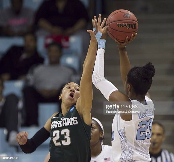 North Carolina Tar Heels' Diamond DeShields puts up a shot against Michigan State Spartans' Aerial Powers for two of her 18 points in the first half...