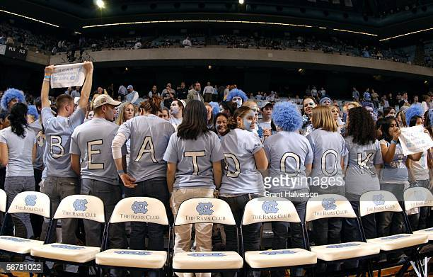 North Carolina Tar Heels fans react as the Duke University Blue Devils warm up before their game February 7 at the Dean Smith Center in Chapel Hill...