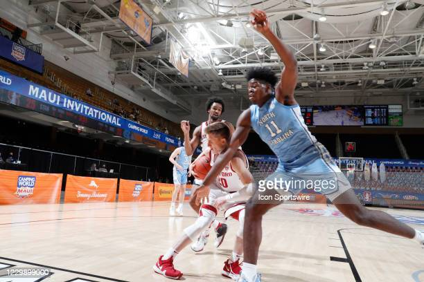 North Carolina Tar Heels forward Day'Ron Sharpe goes after a loose ball against Stanford Cardinal guard Noah Taitz during the first half of the...