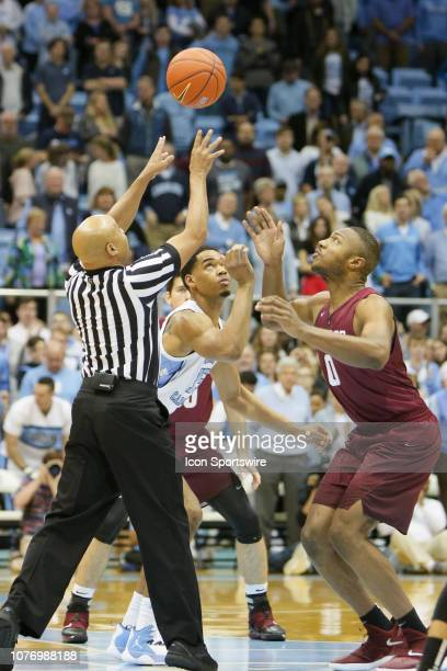 North Carolina Tar Heels forward Garrison Brooks and Harvard Crimson forward Chris Lewis go for the tip off on January 2 at the Dean Smith Center in...