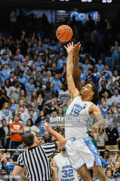 North Carolina Tar Heels forward Garrison Brooks gets the jump ball to start the overtime period during the college basketball game between Miami...