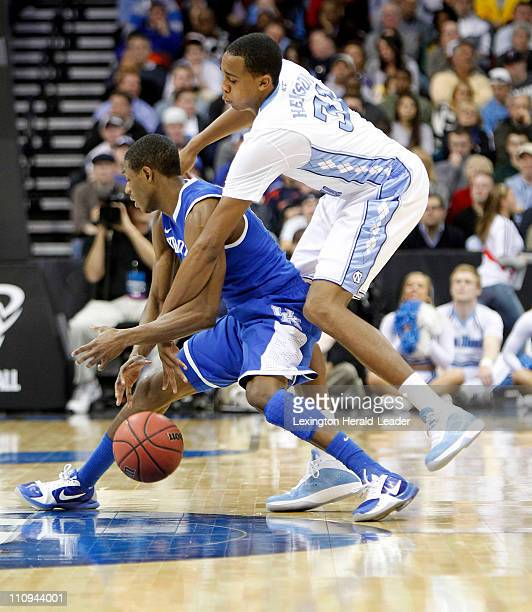 North Carolina Tar Heels forward John Henson fouled Kentucky Wildcats guard Brandon Knight during the Elite 8 in the men's NCAA East Regional...