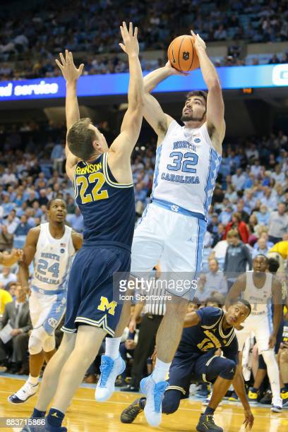 North Carolina Tar Heels forward Luke Made shoots the ball while being defended by Michigan Wolverines guard Duncan Robinson during the first half at...