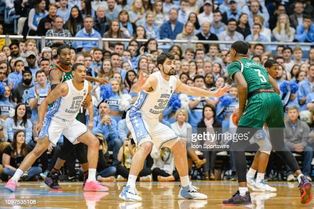 North Carolina Tar Heels forward Luke Maye defends Miami Hurricanes guard Anthony Lawrence II during the college basketball game between Miami...