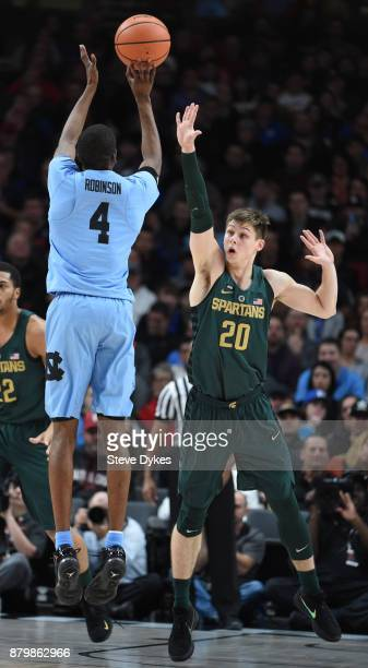North Carolina Tar Heels guard Brandon Robinson shoots the ball over Michigan State Spartans guard Matt McQuaid in the first half of the game during...