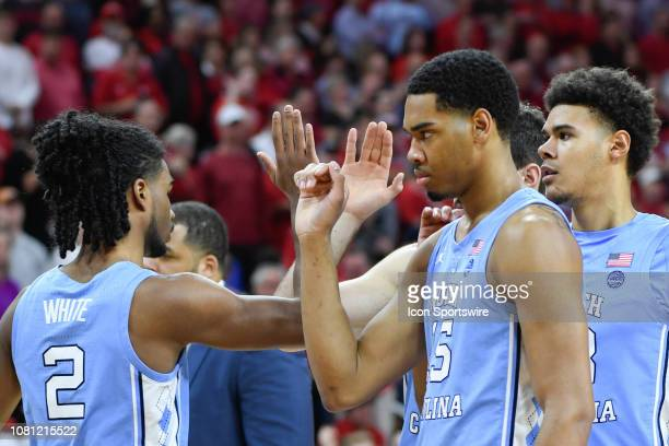 North Carolina Tar Heels guard Coby White and North Carolina Tar Heels forward Garrison Brooks during introductions at the college basketball game...