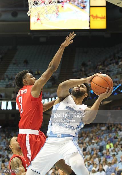 North Carolina Tar Heels guard Joel Berry II is challenged by Radford Highlanders guard Christian Bradford during the NCAA Men's Basketball game...