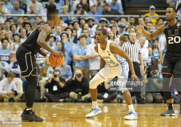 North Carolina Tar Heels guard Kenny Williams guards Miami Hurricanes guard Lonnie Walker IV during the game between the Miami Hurricanes and the...