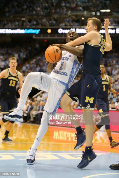 North Carolina Tar Heels guard Theo Pinson drives to the basket while being defended by Michigan Wolverines guard Duncan Robinson during the first...