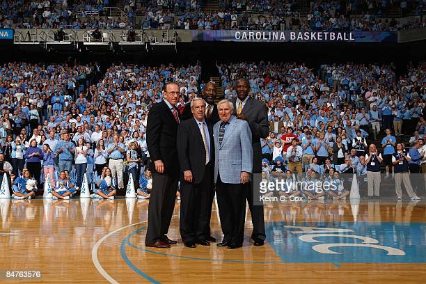 North Carolina Tar Heels Hall of Famers Billy Cunningham Roy Williams James Worthy Dean Smith and Bob McAdoo are honored during halftime of the game...