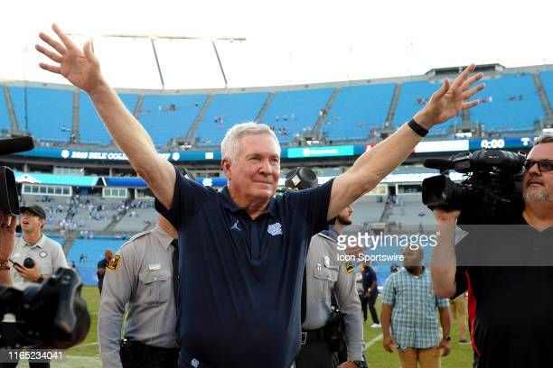 North Carolina Tar Heels head coach Mack Brown waves to the fans after getting the win in his first game back at UNC in the Belk College Kickoff game...