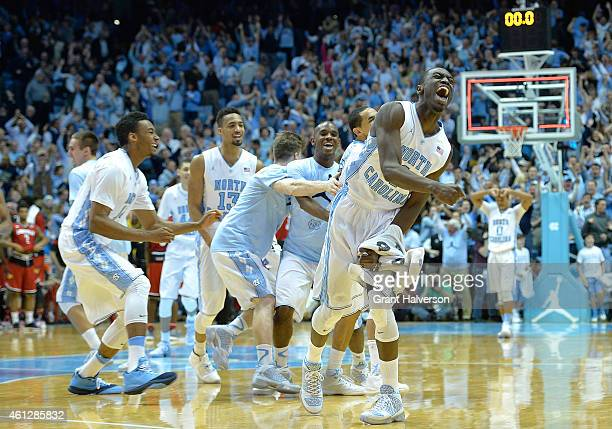 North Carolina Tar Heels players celebrate after a win against the Louisville Cardinals at the Dean Smith Center on January 10 2015 in Chapel Hill...