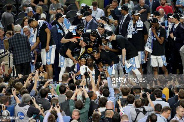 North Carolina Tar Heels players celebrate with the trophy following the 2017 NCAA Men's Final Four National Championship game against the Gonzaga...