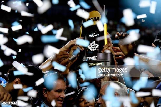 North Carolina Tar Heels players raise the trophy during the 2017 NCAA Photos via Getty Images Men's Final Four National Championship game against...