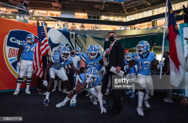 North Carolina Tar Heels wait to take the field prior to the game against the Texas A&M Aggies at the Capital One Orange Bowl at Hard Rock Stadium on...
