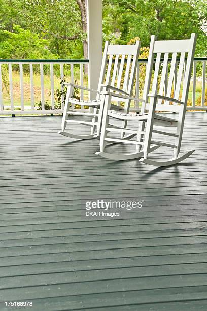 usa, north carolina, two white rocking chairs on porch - rocking chair stock pictures, royalty-free photos & images
