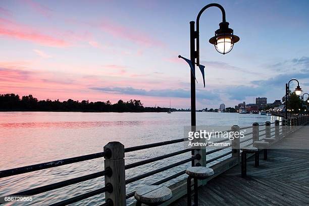 usa, north carolina, wilmington, riverbank at sunset - wilmington north carolina stock photos and pictures