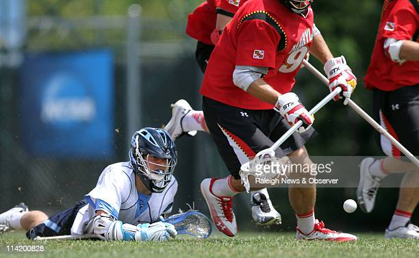 North Carolina's Billy Bitter loses the ball to Maryland's defenders during the second half of the men's NCAA lacrosse tournament at Fetzer Field in...