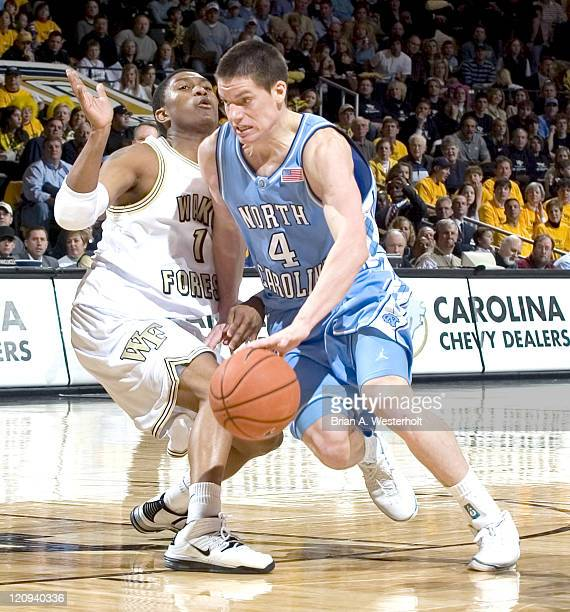 North Carolina's Bobby Frasor drives past Wake Forest's Justin Gray during second half action at the LJVM Coliseum in WinstonSalem North Carolina Feb...