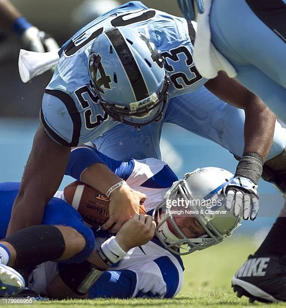 North Carolina's Darius Lipford sacks Middle Tennessee State quarterback Logan Kilgore for a 7yard loss in the second quarter at Kenan Stadium in...